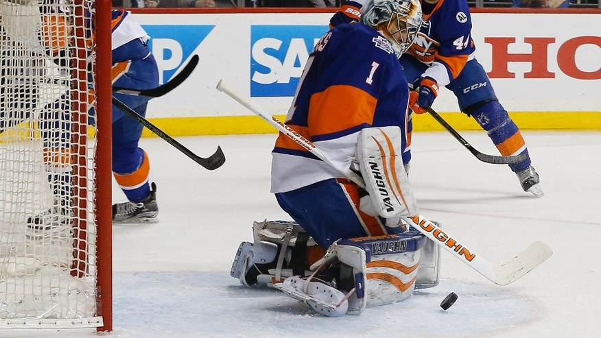 New York Islanders goalie Thomas Greiss (1) blocks a shot by the Florida Panthers during the first period of Game 4 of an NHL hockey first-round Stanley Cup playoff series, Wednesday, April 20, 2016, in New York. (AP Photo/Julie Jacobson)