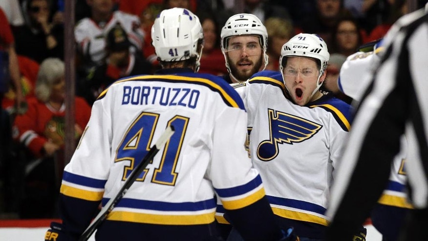 St. Louis Blues right wing Vladimir Tarasenko, right, celebrates with his teammates after scoring a goal against the Chicago Blackhawks during the first period in Game 4 of an NHL hockey first-round Stanley Cup playoff series Tuesday, April 19, 2016, in Chicago. (AP Photo/Nam Y. Huh)