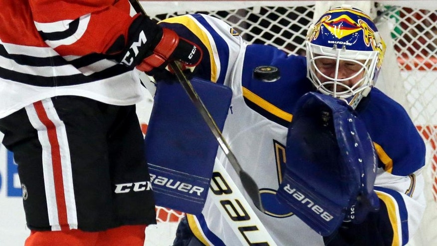 St. Louis Blues goalie Brian Elliott blocks a shot by Chicago Blackhawks right wing Andrew Shaw during the second period in Game 4 of an NHL hockey first-round Stanley Cup playoff series Tuesday, April 19, 2016, in Chicago. (AP Photo/Nam Y. Huh)