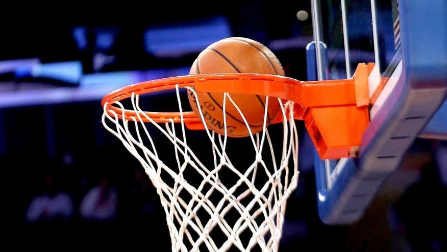 <p>NEW YORK, NY - NOVEMBER 20: A closeup of a basketball and rim prior to the game between the New York Knicks and the Indiana Pacers at Madison Square Garden on November 20, 2013 in New York City. NOTE TO USER: User expressly acknowledges and agrees that, by downloading and or using this Photograph, user is consenting to the terms and conditions of the Getty Images License Agreement. The Pacers defeated the Knicks 103-96 in overtime. (Photo by Bruce Bennett/Getty Images)</p>