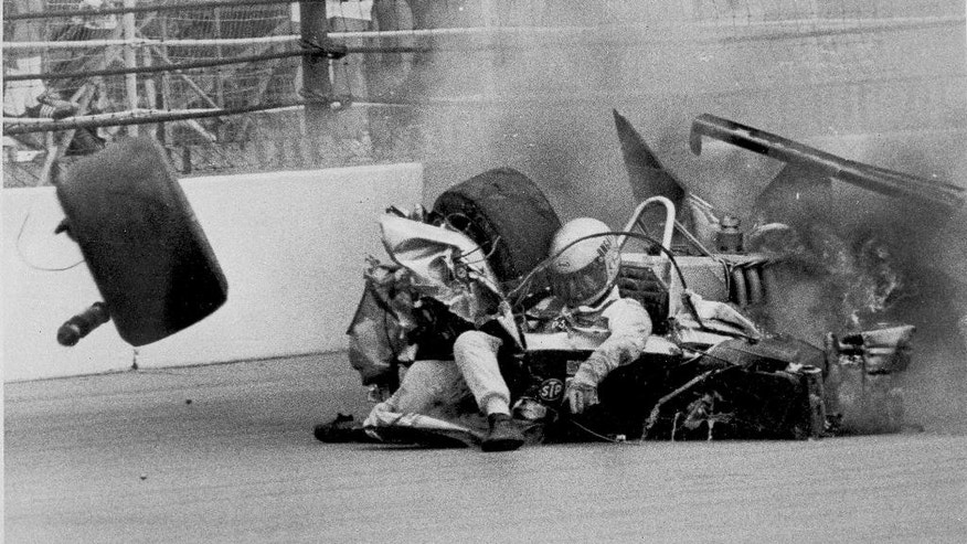 FILE - In this May 25, 1981 file photo, Danny Ongais hits the wall in the third turn on the 64th lap of the 65th running of the Indianapolis 500 auto race at Indianapolis Motor Speedway in Indianapolis, Ind. Ongais was hospitalized with multiple fractures. (AP Photo/File)