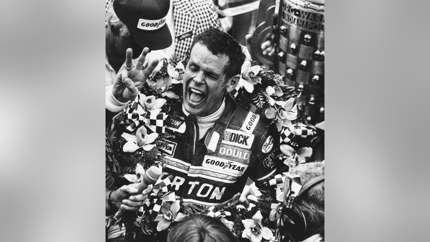 FILE - In this May 24, 1981 file photo, Bobby Unser celebrates after winning the 65th running of the Indianapolis 500 auto race at Indianapolis Motor Speedway in Indianapolis, Ind. Unser was issued a one-position penalty after the race and Mario Andretti was declared the winner. Then after a lengthy protest and appeals process, the penalty was rescinded and Unser was reinstated as the winner.  (AP Photo/File)