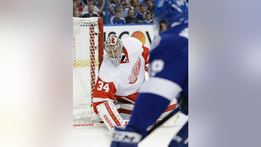 Detroit Red Wings goalie Petr Mrazek (34), of the Czech Republic, makes a save on a shot by Tampa Bay Lightning defenseman Nikita Nesterov (89), of Russia, during the second period of Game 5 in a first-round NHL hockey Stanley Cup playoff series Thursday, April 21, 2016, in Tampa, Fla. (AP Photo/Chris O'Meara)