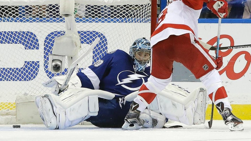 Tampa Bay Lightning goalie Ben Bishop (30) makes a save on a shot by Detroit Red Wings left wing Justin Abdelkader (8) during the second period of Game 5 in a first-round NHL hockey Stanley Cup playoff series Thursday, April 21, 2016, in Tampa, Fla. (AP Photo/Chris O'Meara)