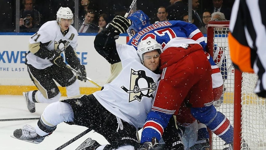 Pittsburgh Penguins left wing Chris Kunitz (14) collides with New York Rangers defenseman Ryan McDonagh (27) during the first period of Game 4 of an NHL hockey first-round Stanley Cup playoff series, Thursday, April 21, 2016, in New York. (AP Photo/Julie Jacobson)