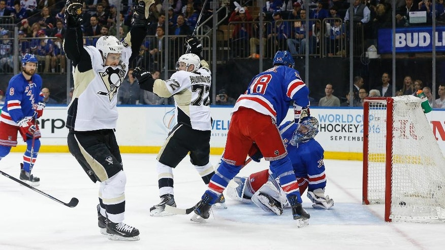 Pittsburgh Penguins center Sidney Crosby, left, and right wing Patric Hornqvist (72) celebrate a goal by Hornqvist against New York Rangers goalie Henrik Lundqvist during the first period of Game 4 of an NHL hockey first-round Stanley Cup playoff series, Thursday, April 21, 2016, in New York. (AP Photo/Julie Jacobson)