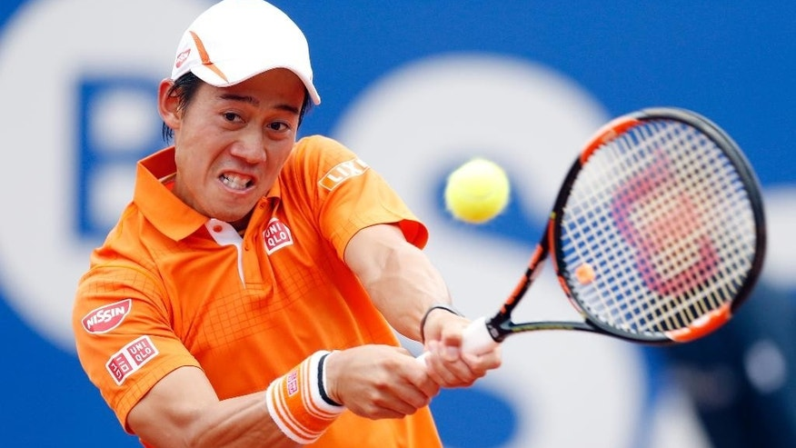 Kei Nishikori of Japan returns the ball to Albert Montanes during the Barcelona open tennis tournament in Barcelona, Spain, Thursday, April 21, 2016. (AP Photo/Manu Fernandez)
