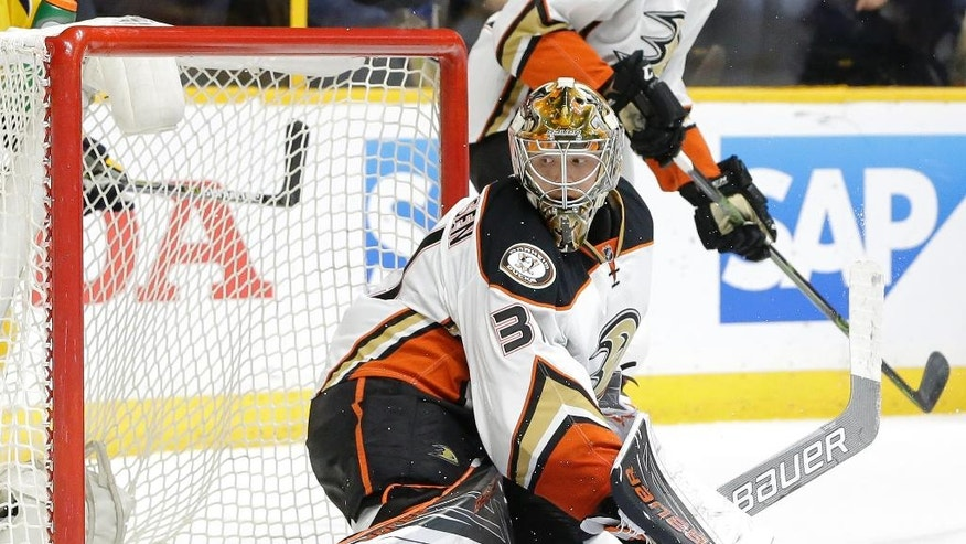 Anaheim Ducks goalie Frederik Andersen, of Denmark, looks back as a shot by Nashville Predators forward Mike Fisher gets past for a goal during the second period of Game 4 in an NHL hockey first-round Stanley Cup playoff series Thursday, April 21, 2016, in Nashville, Tenn. (AP Photo/Mark Humphrey)