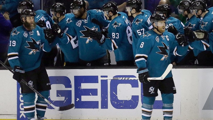 San Jose Sharks' Joe Pavelski, right, and Joe Thornton (19) are congratulated after Pavelski's goal against the Los Angeles Kings during the second period of Game 4 of an NHL hockey first-round Stanley Cup playoff series Wednesday, April 20, 2016, in San Jose, Calif. (AP Photo/Ben Margot)