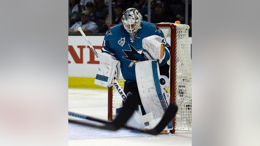 San Jose Sharks goalie Martin Jones blocks a shot from the Los Angeles Kings during the second period of Game 4 of an NHL hockey first-round Stanley Cup playoff series Wednesday, April 20, 2016, in San Jose, Calif. (AP Photo/Ben Margot)