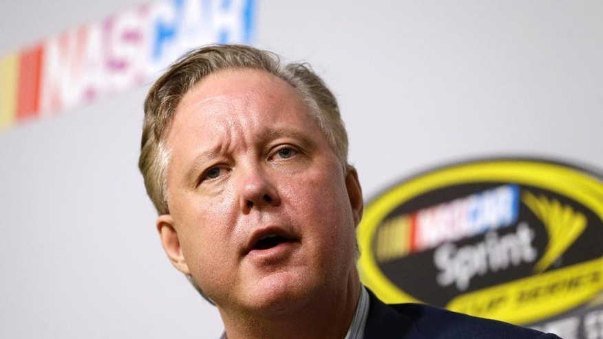 FILE - In this Nov. 20, 2015, file photo, Brian France, NASCAR Chairman and CEO, talks to reporters at a news conference during NASCAR Championship auto racing weekend at Homestead-Miami Speedway in Homestead, Fla. At a time when other sports are leading the charge toward a brighter social future, the good ol' boys seem intent on returning us to a more divisive era. (AP Photo/Alan Diaz, File)