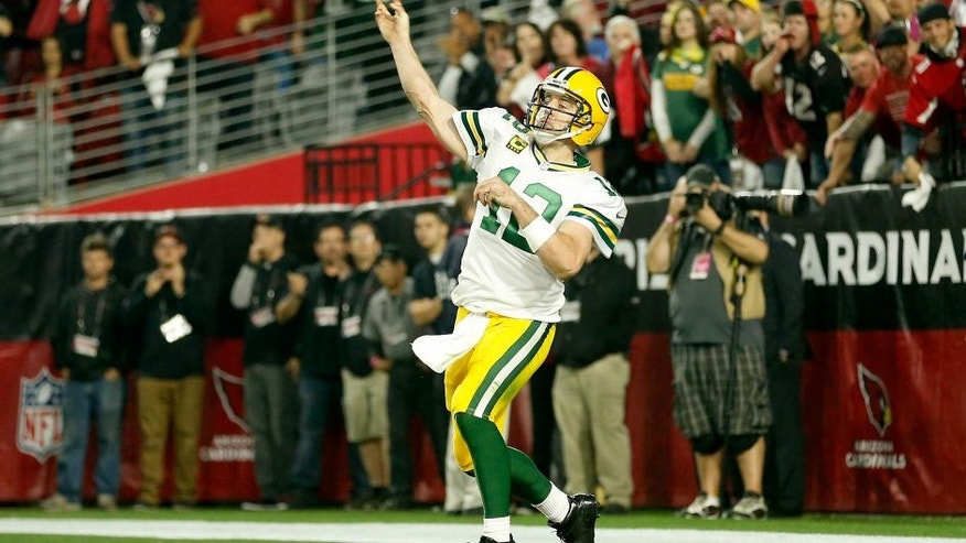 GLENDALE, AZ - JANUARY 16: Quarterback Aaron Rodgers #12 of the Green Bay Packers launches a pass during the final seconds of the fourth quarter of the NFC Divisional Playoff Game at University of Phoenix Stadium on January 16, 2016 in Glendale, Arizona. The Arizona Cardinals beat the Green Bay Packers 26-20 in overtime. (Photo by Christian Petersen/Getty Images)