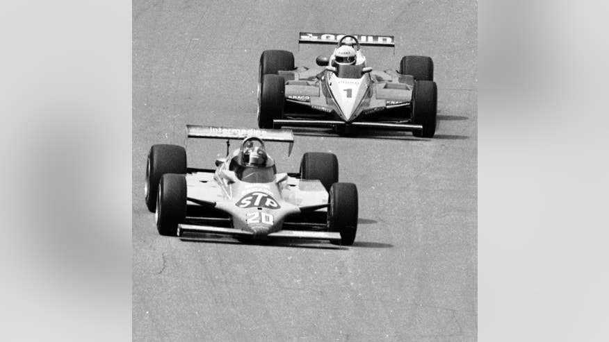 FILE -  In this May 30, 1982 file photo, driver Gordon Johncock (20) leads pole-sitter Rick Mears  down the straightway into turn one during the closing laps in the 66th running of the Indianapolis 500 auto race at Indianapolis Motor Speedway in Indianapolis, Ind. . (AP Photo/File)