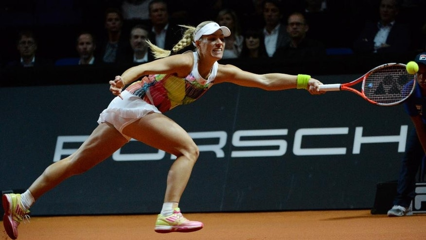 Germany's Angelique Kerber returns a shot to Spain's Carla Suarez Navarro during their quarterfinal match at the WTA tennis tournament in Stuttgart, Germany, Friday, April 22, 2016. (Marijan Murat/dpa via AP)