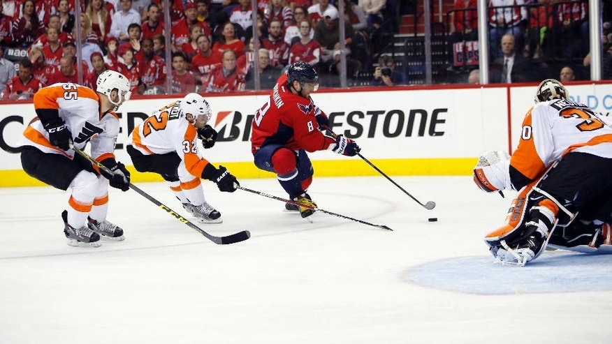 Washington Capitals left wing Alex Ovechkin (8), from Russia, prepares a shot that was then stopped by Philadelphia Flyers goalie Michal Neuvirth (30), from the Czech Republic, during the second period of Game 5 in the first round of the NHL Stanley Cup hockey playoffs, Friday, April 22, 2016, in Washington. (AP Photo/Alex Brandon)