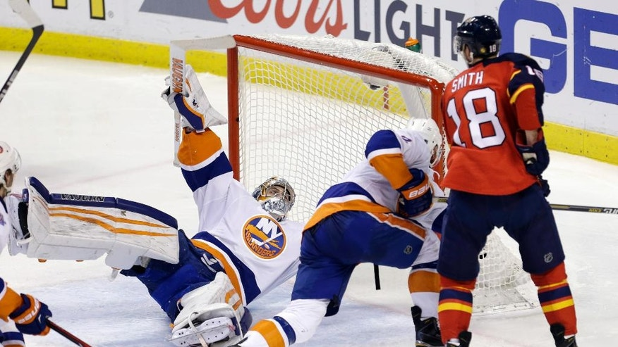 New York Islanders goalie Thomas Greiss (1) and Nick Leddy (2) defend against Florida Panthers right wing Reilly Smith (18 )during the second period of Game 5 of an NHL hockey first-round Stanley Cup playoff series, Friday, April 22, 2016, in Sunrise, Fla. (AP Photo/Alan Diaz)