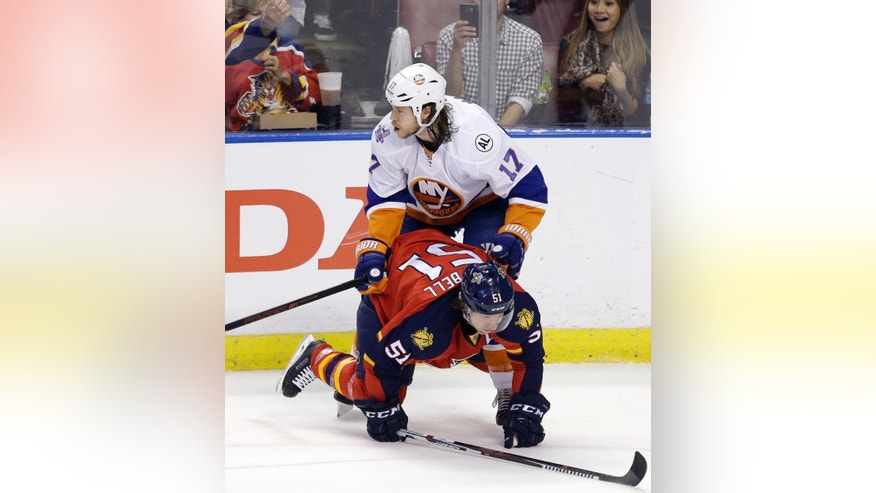 Florida Panthers defenseman Brian Campbell (51) is checked by New York Islanders left wing Matt Martin (17) during the first period of Game 5 of an NHL hockey first-round Stanley Cup playoff series, Friday, April 22, 2016, in Sunrise, Fla. (AP Photo/Alan Diaz)