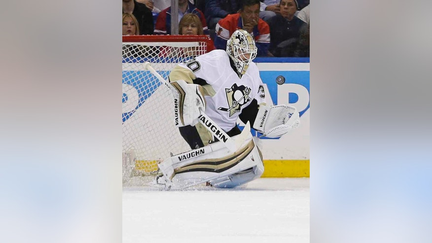 Pittsburgh Penguins goalie Matt Murray stops a shot by the New York Rangers during the first period of Game 3 of a first-round NHL playoff hockey series Tuesday, April 19, 2016, in New York. (AP Photo/Frank Franklin II)