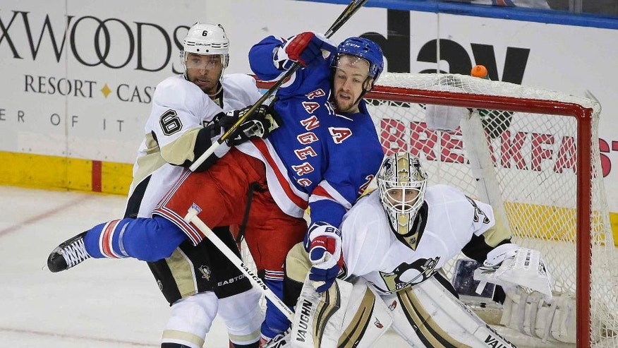 Pittsburgh Penguins' Trevor Daley (6) and Matt Murray (30) defend the goal as New York Rangers' Derek Stepan (21) fights for position during the third period of Game 3 of a first-round NHL playoff hockey series Tuesday, April 19, 2016, in New York. The Penguins won 3-1. (AP Photo/Frank Franklin II)
