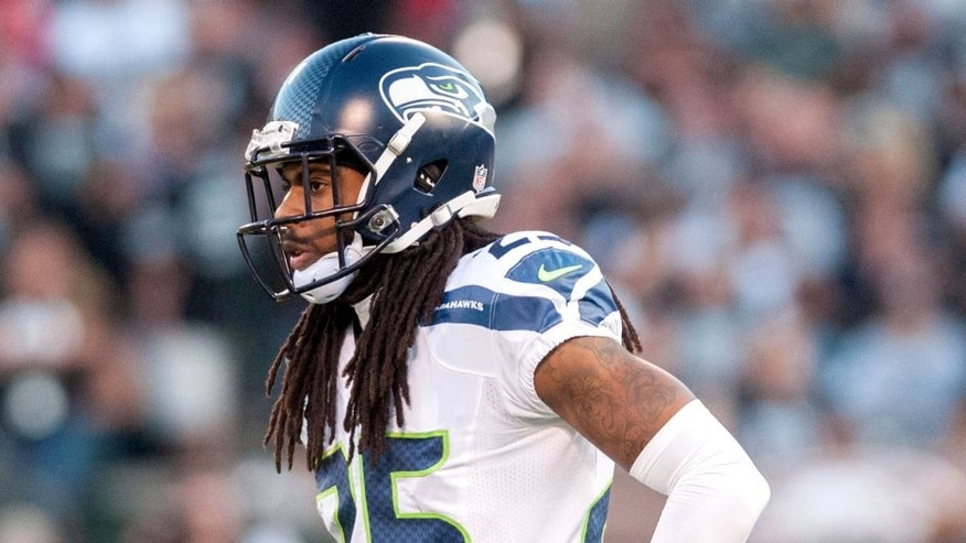 Aug 28, 2014; Oakland, CA, USA; Seattle Seahawks cornerback Richard Sherman (25) looks on during the first quarter of the game against the Oakland Raiders at O.co Coliseum. Mandatory Credit: Ed Szczepanski-USA TODAY Sports
