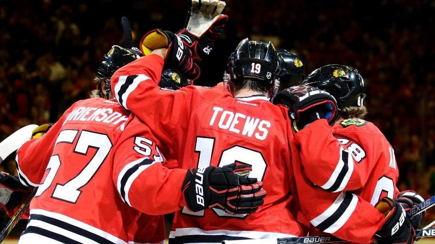 Chicago Blackhawks defenseman Trevor van Riemsdyk (57) celebrates with teammates after scoring a goal against the St. Louis Blues during the second period in Game 6 of an NHL hockey first-round Stanley Cup playoff series Saturday, April 23, 2016, in Chicago. (AP Photo/Nam Y. Huh)