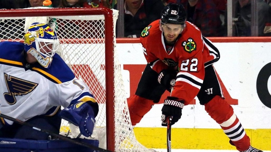 Chicago Blackhawks center Marcus Kruger, right, shoots against St. Louis Blues goalie Brian Elliott during the second period in Game 6 of an NHL hockey first-round Stanley Cup playoff series Saturday, April 23, 2016, in Chicago. (AP Photo/Nam Y. Huh)