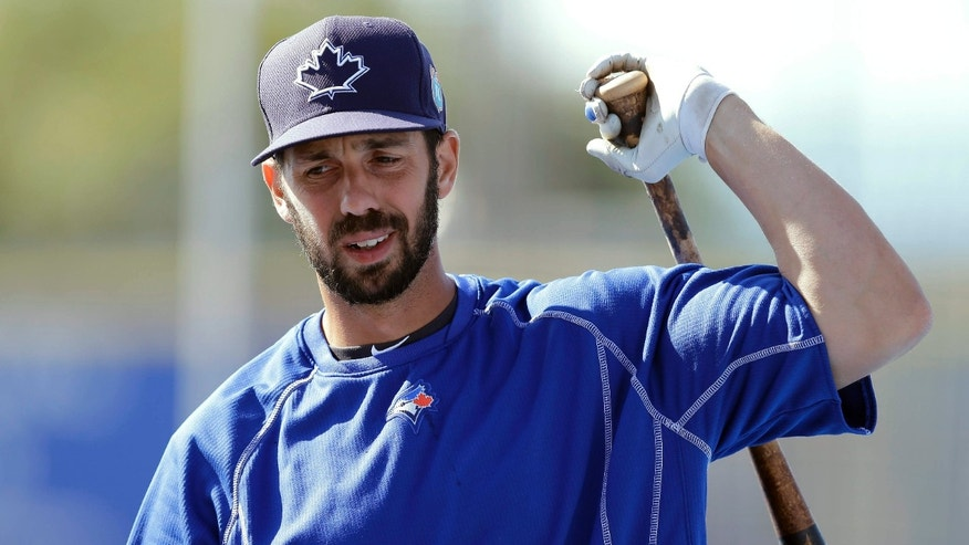 FILE - In this March 23, 2016, file photo, Toronto Blue Jays' Chris Colabello loosens up before a spring training baseball game against the New York Mets in Dunedin, Fla.