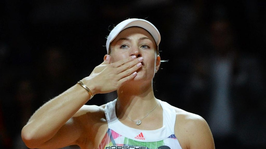 Angelique Kerber from Germany celebrates after winning the semifinal match against Petra Kvitova from Czech Republic at the WTA tournament in Stuttgart, Germany, Saturday, April 23, 2016. (Marijan Murat/dpa via AP)