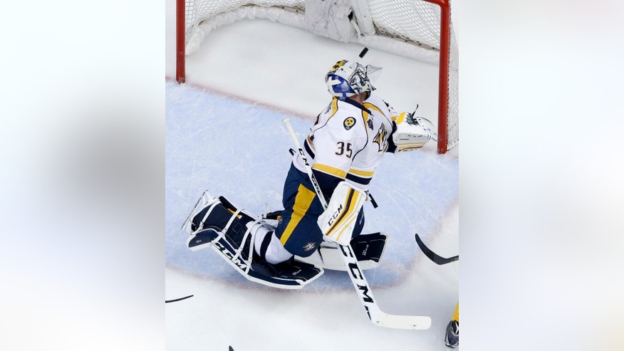 Nashville Predators goalie Pekka Rinne watches a goal by Anaheim Ducks left wing David Perron during the second period of Game 5 in an NHL hockey Stanley Cup playoffs first-round series in Anaheim, Calif., Saturday, April 23, 2016. (AP Photo/Chris Carlson)