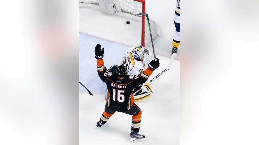 Anaheim Ducks left wing Ryan Garbutt celebrates after left wing David Perron scored past Nashville Predators goalie Pekka Rinne during the second period of Game 5 in an NHL hockey Stanley Cup playoffs first-round series in Anaheim, Calif., Saturday, April 23, 2016. (AP Photo/Chris Carlson)