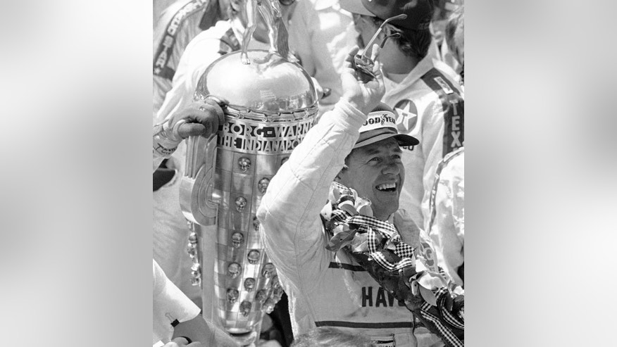 FILE - In this May 29, 1983 file photo, Tom Sneva waves to race fans from victory lane after winning the 67th running of the Indianapolis 500 auto race at Indianapolis Motor Speedway in Indianapolis, Ind.   (AP Photo/Charlie Bennett)