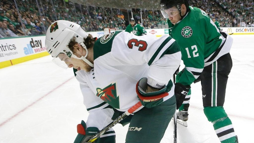 Minnesota Wild center Charlie Coyle (3) and Dallas Stars center Radek Faksa (12) skate for control of the puck during the second period in Game 5 of a first-round NHL hockey Stanley Cup playoff series, Friday, April 22, 2016, in Dallas. (AP Photo/LM Otero)