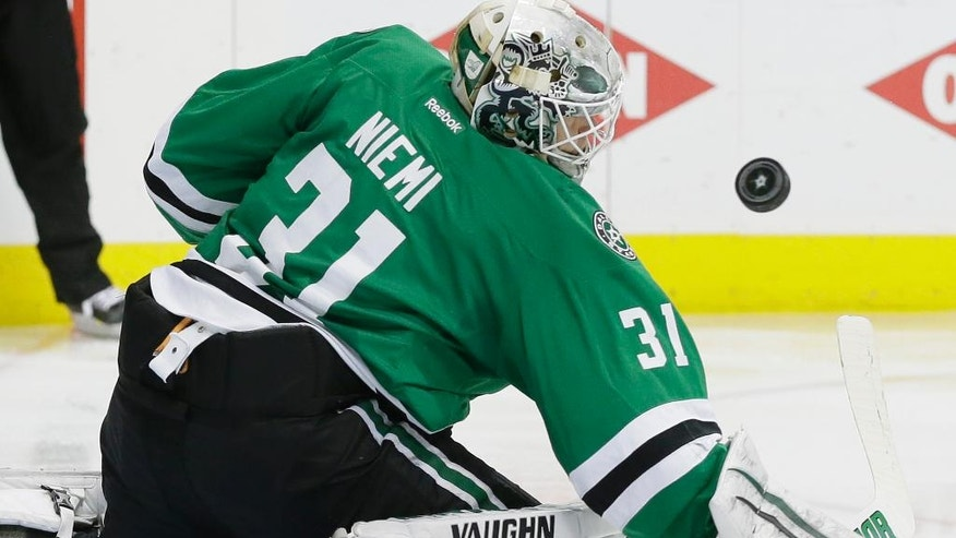 Dallas Stars goalie Antti Niemi blocks a Minnesota Wild shot during the second period in Game 5 of a first-round NHL hockey Stanley Cup playoff series, Friday, April 22, 2016, in Dallas. (AP Photo/LM Otero)