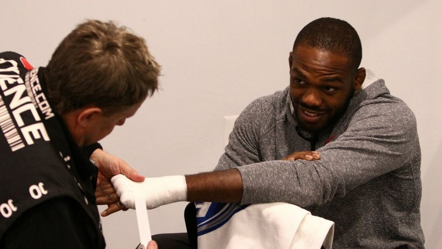 """BALTIMORE, MD - APRIL 26: Jon """"Bones"""" Jones has his hands wrapped before his light heavyweight championship bout against Glover Teixeira during the UFC 172 event at the Baltimore Arena on April 26, 2014 in Baltimore, Maryland. (Photo by Mike Roach/Zuffa LLC/Zuffa LLC via Getty Images) *** Local Caption *** Jon Jones"""