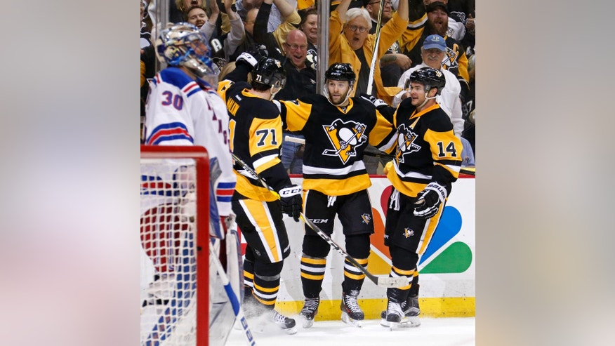 New York Rangers goalie Henrik Lundqvist (30) looks away as Pittsburgh Penguins' Bryan Rust, center, celebrates his second goal of the second period in Game 5 of a first-round NHL playoff hockey game in Pittsburgh, Saturday, April 23, 2016. (AP Photo/Gene J. Puskar)