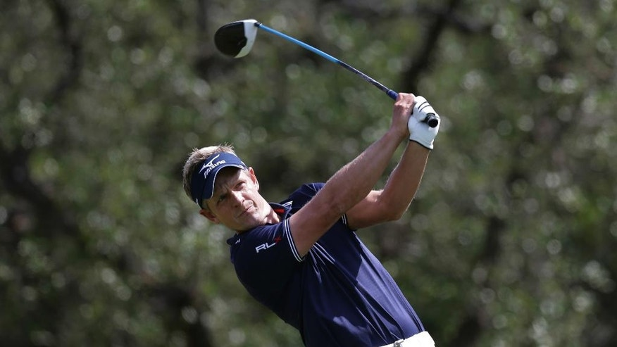 Luke Donald, of England, hits his tee shot on the first hole during the third round of the Texas Open golf tournament, Saturday, April 23, 2016, in San Antonio. (AP Photo/Eric Gay)