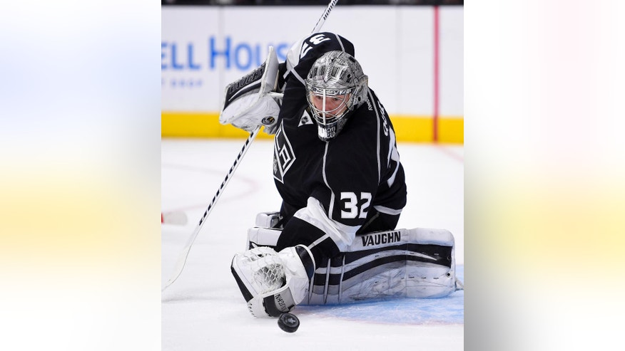 Los Angeles Kings goalie Jonathan Quick stops a shot during the first period of Game 5 in an NHL hockey Stanley Cup playoffs first-round series against the San Jose Sharks, Friday, April 22, 2016, in Los Angeles. (AP Photo/Mark J. Terrill)