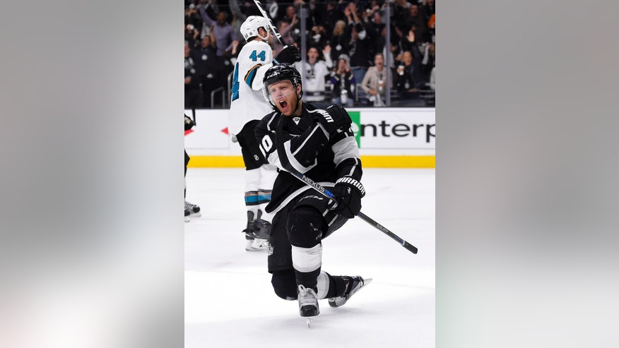 Los Angeles Kings right wing Kris Versteeg celebrates his goal as San Jose Sharks defenseman Marc-Edouard Vlasic skates in the background during the second period of Game 5 in an NHL hockey Stanley Cup playoffs first-round series, Friday, April 22, 2016, in Los Angeles. (AP Photo/Mark J. Terrill)