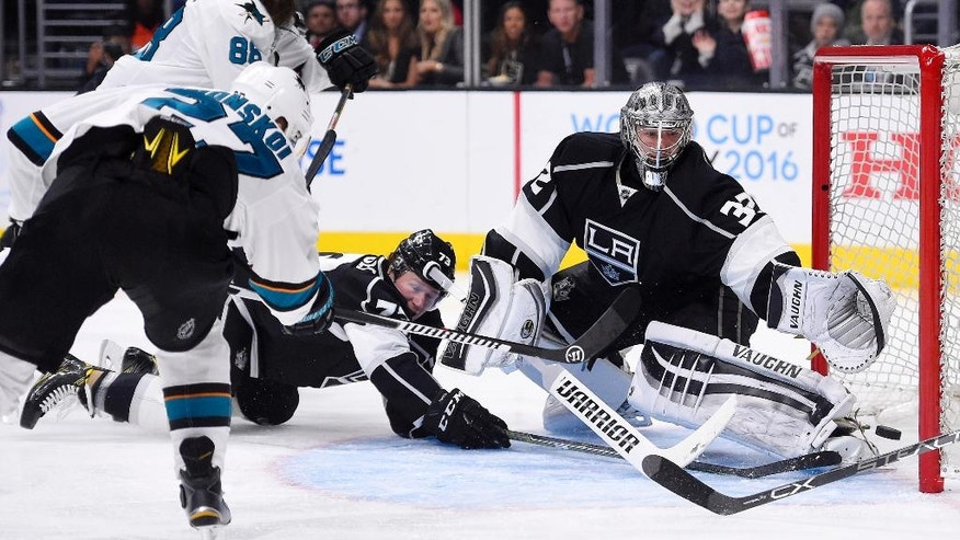 San Jose Sharks right wing Joonas Donskoi, of Finland, scores on Los Angeles Kings goalie Jonathan Quick, right, as center Tyler Toffoli, center, tries to defend during the third period of Game 5 in an NHL hockey Stanley Cup playoffs first-round series, Friday, April 22, 2016, in Los Angeles. The Sharks won 6-3. (AP Photo/Mark J. Terrill)