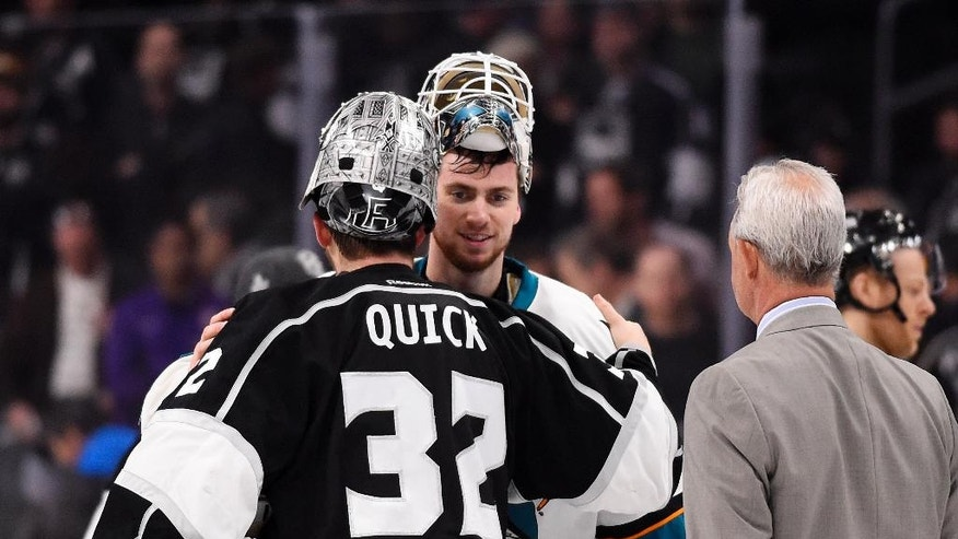 Los Angeles Kings goalie Jonathan Quick, left, and San Jose Sharks goalie Martin Jones, center, greet one another as Kings coach Darryl Sutter watches after Game 5 in an NHL hockey Stanley Cup playoffs first-round series, Friday, April 22, 2016, in Los Angeles. The Sharks won 6-3. (AP Photo/Mark J. Terrill)