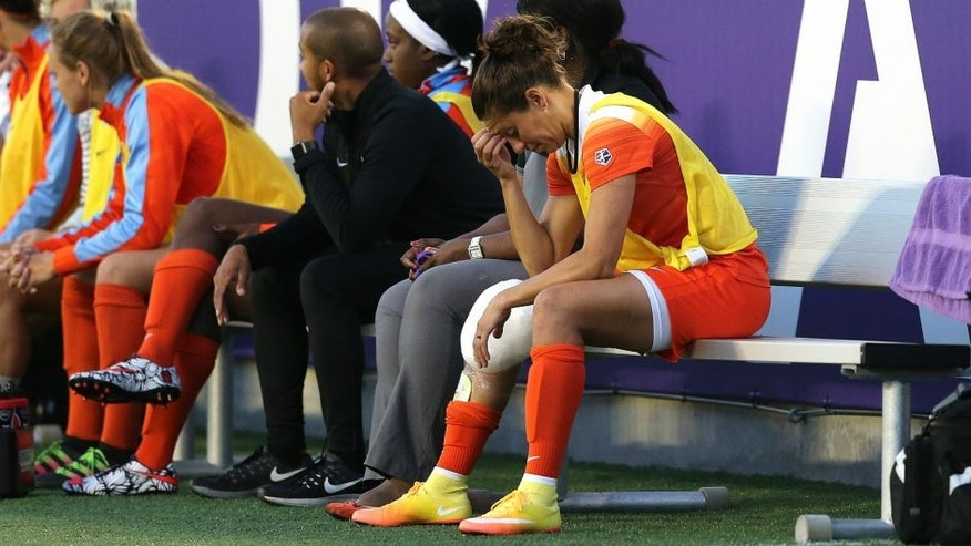 ORLANDO, FL - APRIL 23: Carli Lloyd #10 of Houston Dash sits on the bench with ice on her knee during a NWSL soccer match against the Orlando Pride at the Orlando Citrus Bowl on April 23, 2016 in Orlando, Florida. (Photo by Alex Menendez/Getty Images)