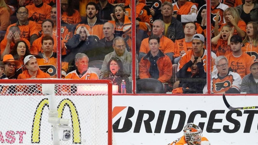 Fans reacts after a goal against Philadelphia Flyers' Michal Neuvirth by Washington Capitals' Nicklas Backstrom during the second period of Game 6 in the first round of the NHL Stanley Cup hockey playoffs, Sunday, April 24, 2016, in Philadelphia. (AP Photo/Matt Slocum)