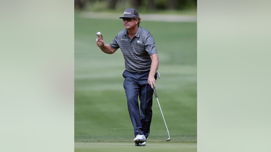 Charley Hoffman reacts to the gallery after making a birdie putt on the 14th hole during the final round of the Texas Open golf tournament, Sunday, April 24, 2016, in San Antonio. (AP Photo/Eric Gay)