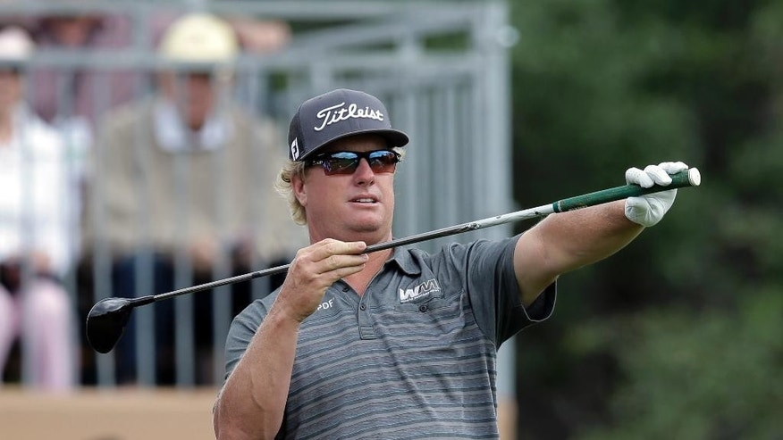 Charley Hoffman lines up his shot on the first hole during the final round of the Texas Open golf tournament, Sunday, April 24, 2016, in San Antonio. (AP Photo/Eric Gay)
