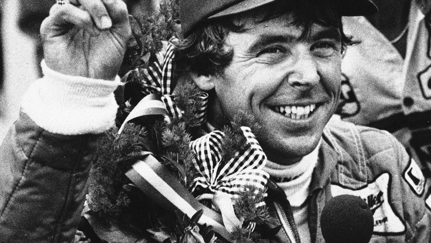FILE - In this May 22, 1984 file photo, Rick Mears signals his second Indianapolis 500 victory after the 68th running of the auto race in Indianapolis, Ind. (AP Photo/Charlie Bennett, File)