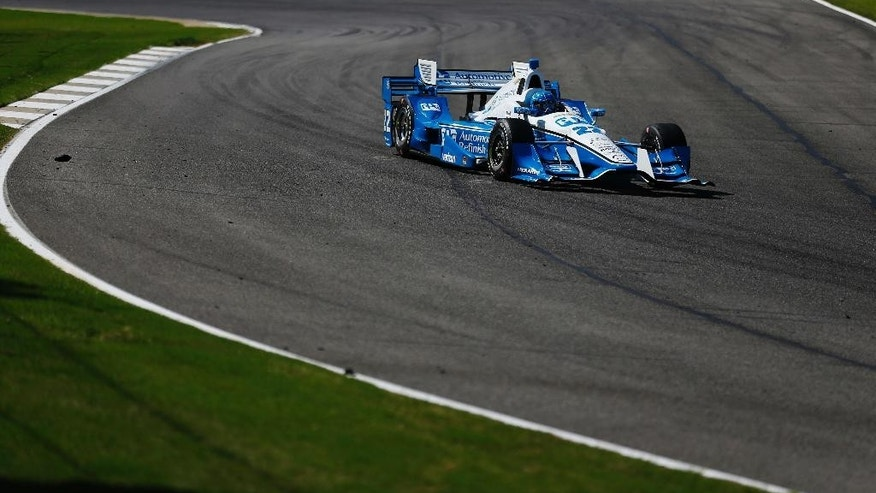 Simon Pagenaud, of Montmorillon, France, rounds the track during the Indy Grand Prix of Alabama auto race, Sunday, April 24, 2016, in Birmingham, Ala. (AP Photo/Brynn Anderson)