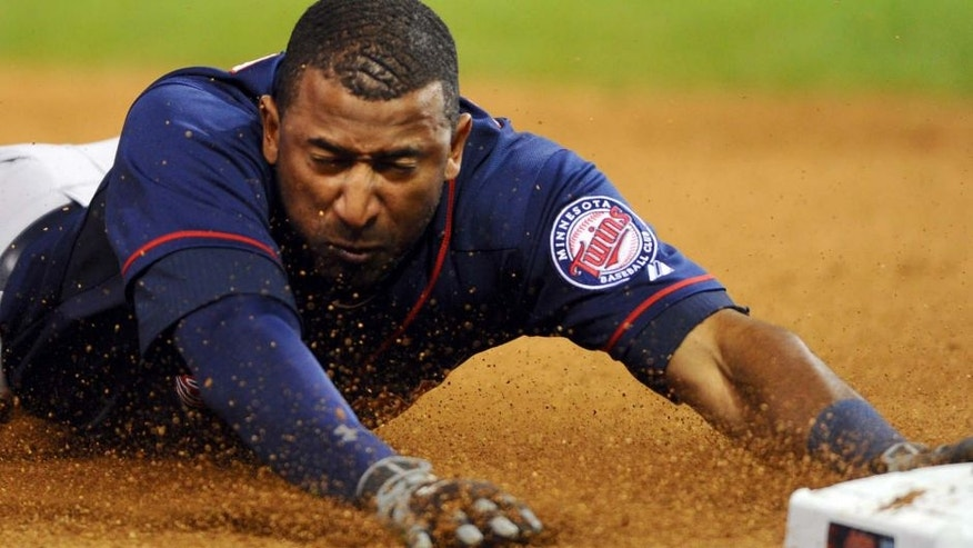 Thursday, Oct. 1: Minnesota Twins pinch runner Eduardo Nunez slides into third during the ninth inning against the Cleveland Indians at Progressive Field. The Twins won 4-2.