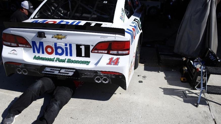 Crews work on Tony Stewart's car before the start of the Sprint Cup auto race at Richmond International Raceway in Richmond, Va., Sunday, April 24, 2016. (AP Photo/Chet Strange)