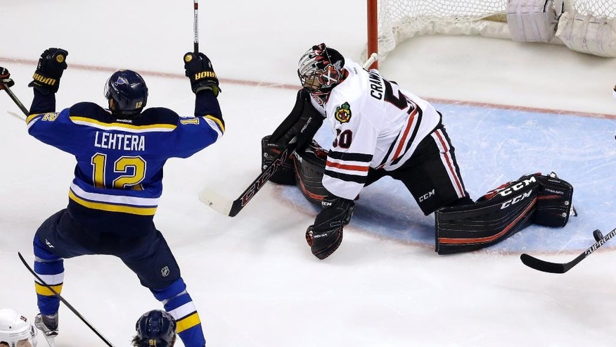 St. Louis Blues' Jori Lehtera, of Finland, celebrates after scoring past Chicago Blackhawks goalie Corey Crawford, right,  during the first period in Game 7 of an NHL hockey first-round Stanley Cup playoff series Monday, April 25, 2016, in St. Louis. (AP Photo/Jeff Roberson)