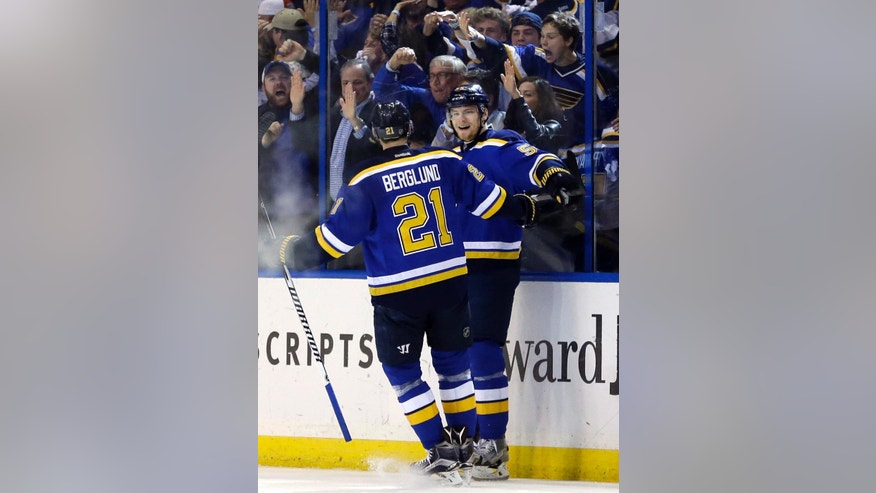 St. Louis Blues' Colton Parayko, right, is congratulated by teammate Patrik Berglund, of Sweden, after scoring during the first period in Game 7 of an NHL hockey first-round Stanley Cup playoff series against the Chicago Blackhawks Monday, April 25, 2016, in St. Louis. (AP Photo/Jeff Roberson)